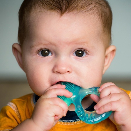 Baby using teething toy