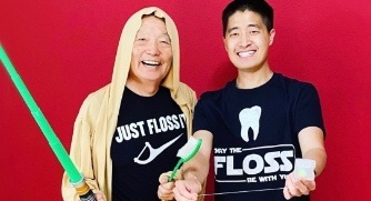 Dentists wearing Star Wars themed flossing shirts