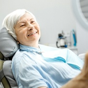 Patient viewing their smile after visiting emergency dentist in Fresno