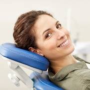 Woman smiling about the cost of emergency dentist in Fresno